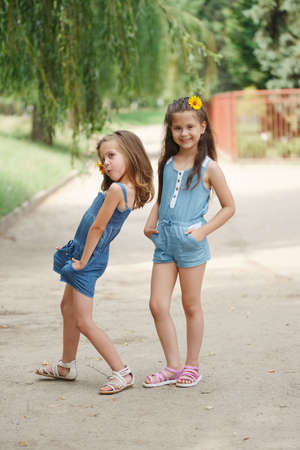 photo of two little girls in summer park
