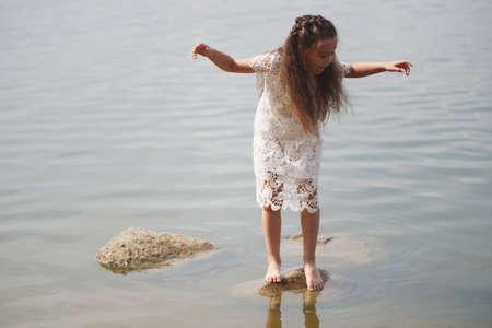 cute happy little girl in sumer lake