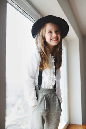portrait of cute happy girl with black hat