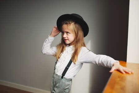 cute little girl with black hat at home Reklamní fotografie