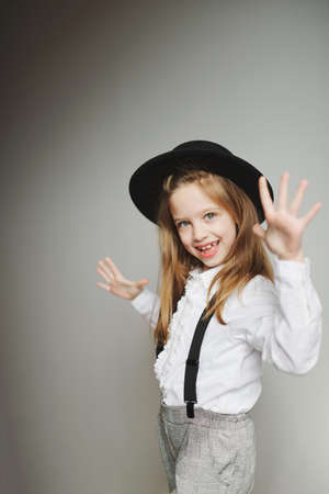 cute little girl with black hat at home 스톡 콘텐츠 - 124400790
