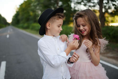 young happy boy and girl together outside Imagens