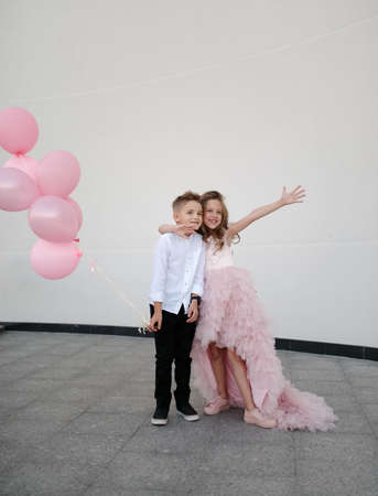 young happy boy and girl together outside