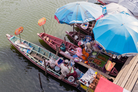 HATYAI - MARCH 3: Wooden boats busy ferrying people at Khlong Hae floating market on March 3, 2016 in Hatyai. Khlong Hae Floating Market is the first floating market of southern Thailand.