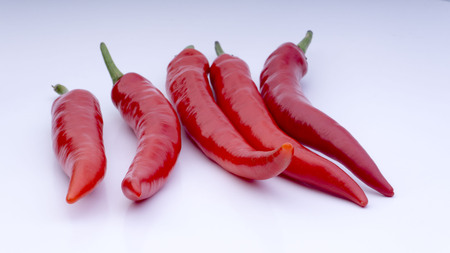 Closeup of red chillies isolated on white background. Stock Photo