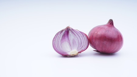 Closeup of red onion on white background.