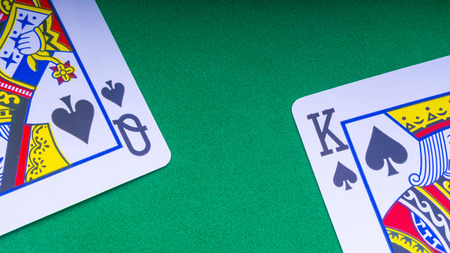 Closeup of playing cards isolated with a white background. 写真素材