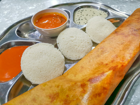 Masala Dosa and Idli Dosa food closeup with selective focus and crop fragment. It is a popular South Indian all time food 写真素材