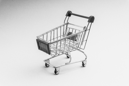 Shopping cart on black and white background, business and shopping concept. Selective focus