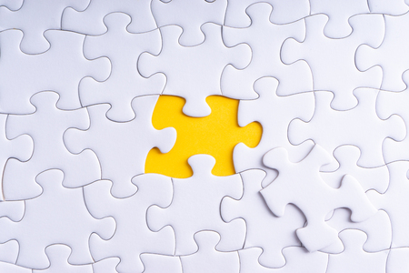 White jigsaw puzzle and missing pieces with selective focus and crop fragment 免版税图像