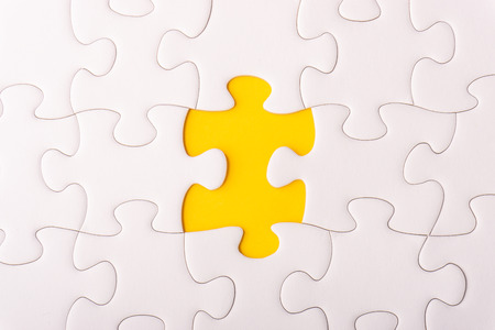 White jigsaw puzzle and missing pieces with selective focus and crop fragment Standard-Bild - 117925843