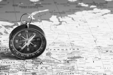 Kuala Lumpur, MALAYSIA FEBRUARY 27, 2019: Compass on world map background. Selective focus,Business and Travel Concept. Black and White