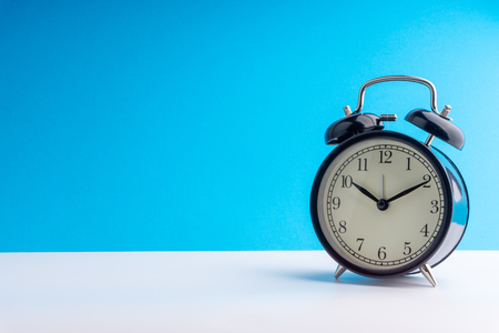 Alarm Clock on colorful background with selective focus and crop fragment. Copy space concept