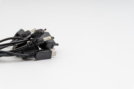 Universal recharger head isolated on white background. Selective focus and crop fragment