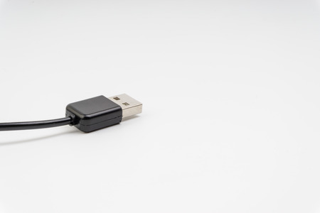Universal recharger head isolated on white background. Selective focus and crop fragment Stock Photo