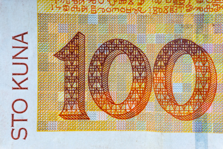 Croatian KUNA or STO KUNA money currency closeup. Selective focus and crop fragment