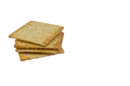 Cracker biscuits over white background. Selective focus 스톡 콘텐츠
