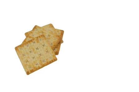 Cracker biscuits over white background. Selective focus Фото со стока