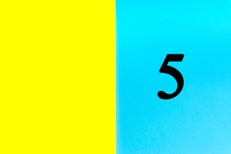 FIVE or 5 written words on blue and yellow background. Number, Calendar, Month, Date and Copy Space concept