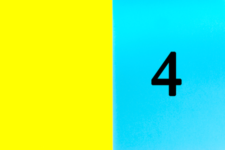 FOUR or 4 written words on blue and yellow background. Number, Calendar, Month, Date and Copy Space concept Stock Photo - 120777414