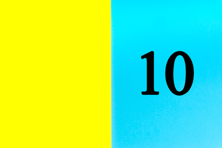 TEN or 10 written words on blue and yellow background. Number, Calendar, Month, Date and Copy Space concept