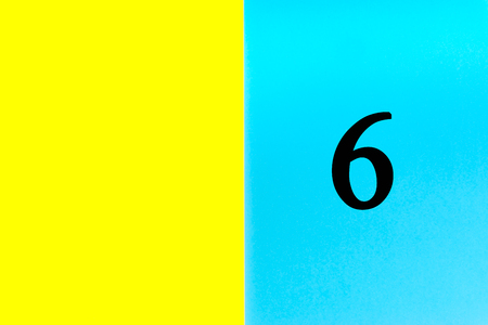 SIX or 6 written words on blue and yellow background. Number, Calendar, Month, Date and Copy Space concept Фото со стока