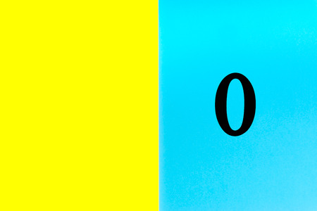 ZERO or 0 written words on blue and yellow background. Number, Calendar, Month, Date and Copy Space concept