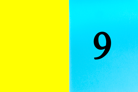 NINE or 9 written words on blue and yellow background. Number, Calendar, Month, Date and Copy Space concept Stock Photo - 120779620