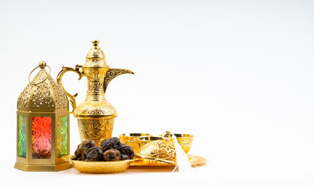 Premium dates, lantern and arabic coffee set on white background. Selective focus, copy space and Ramadan Kareem concept