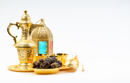Premium dates, lantern and arabic coffee set on white background. Selective focus, copy space and Ramadan Kareem concept