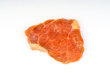 Fresh raw beef meat slices isolated over white background. Selective focus