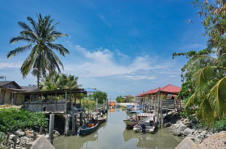 Kuala Selangor, Malaysia - May 19, 2019 : Fisherman village and jetty for boats at Jeram, Kuala Selangor. Selective focus 新聞圖片