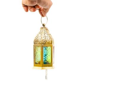 Hand holding arabic lantern isolate on white. Selective focus Reklamní fotografie - 123814095