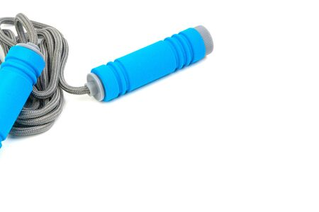 Skipping rope or jumping rope isolated on white background. Selective focus and crop fragment 免版税图像