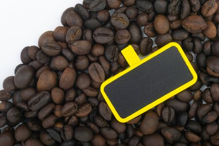Coffee beans and chalk board closeup with selective focus