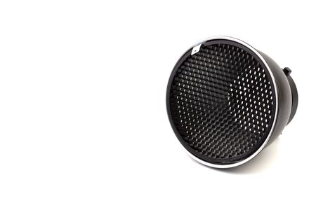 Reflector with honeycomb grid accessory for studio strobes and flashes on white background. Selective focus 免版税图像 - 130504065
