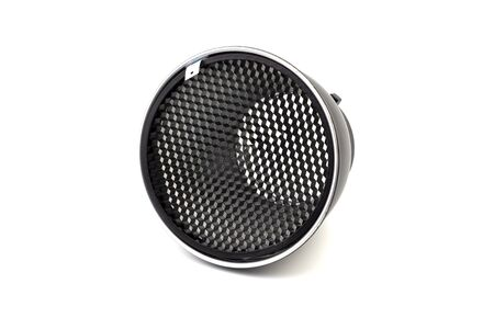 Reflector with honeycomb grid accessory for studio strobes and flashes on white background. Selective focus