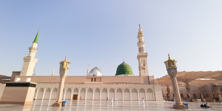 Medina, Saudi Arabia - March 22, 2018 : Exterior view of Nabawi Mosque (Prophet Mosque) building in Medina. Selective focus