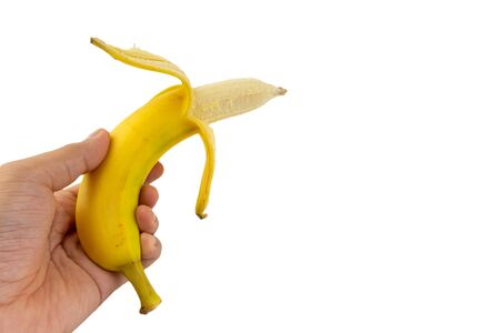 Hand holding Banana isolated on white background 写真素材 - 132105218