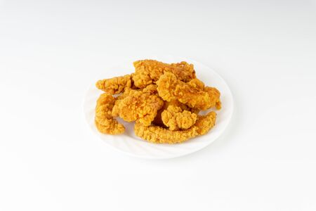Fried breaded chicken fillet isolated on white background