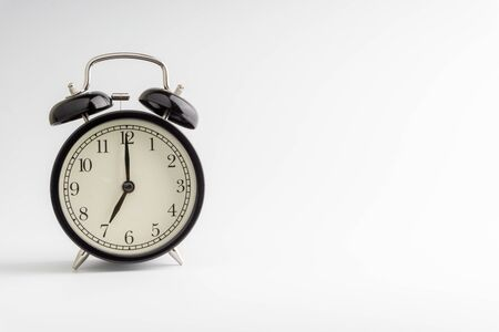 Alarm Clock isolated on white background with selective focus and crop fragment