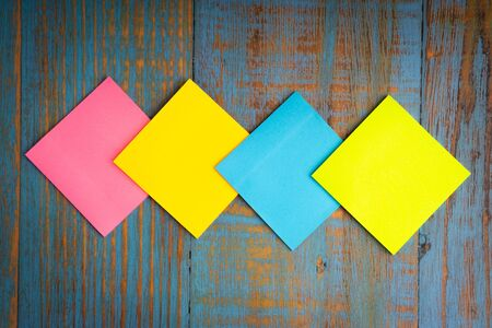 Minimalist flat lay composition of sticky notes on the wooden table top view. Copy space concept Stok Fotoğraf