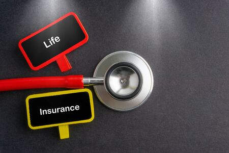 LIFE INSURANCE. Medicine concept. Blackboard with word LIFE INSURANCE and stethoscope