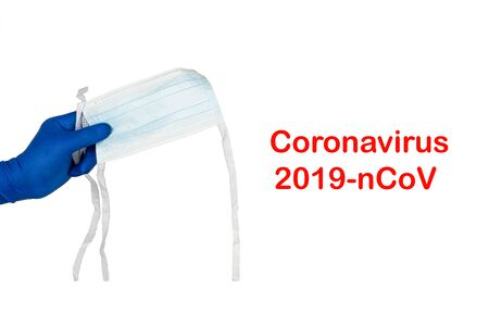 CORONAVIRUS 2019 NCOV text and hands holding protection mask on white background. Healthcare and copy space concept Stok Fotoğraf