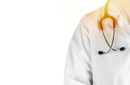 Stethoscope and doctor on white background. Selective focus and crop fragment