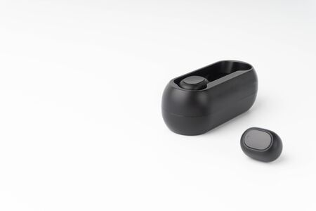 Wireless earbuds or earphones on white background. Copy space and technology concept