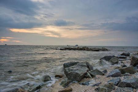 Peaceful beach view and waves during sunset at Jeram, Kuala Selangor Malaysia