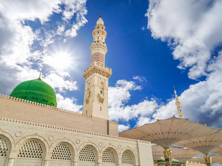 Madinah, Saudi Arabia - July 07, 2020: View of cloudy blue sky at Nabawi Mosque or Prophet Mosque in Madinah, Saudi Arabia. Selective focus