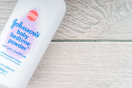 Kuala Lumpur, Malaysia - October 19, 2020 : Johnson and Johnson Baby bedtime powder talcum on wooden background