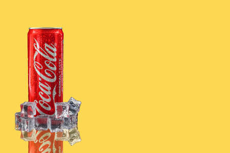 Kuala Lumpur, Malaysia - October 19, 2020 : Coca Cola or Coke Drink on yellow background Editöryel